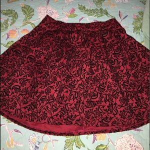 Bright red mini designed skirt